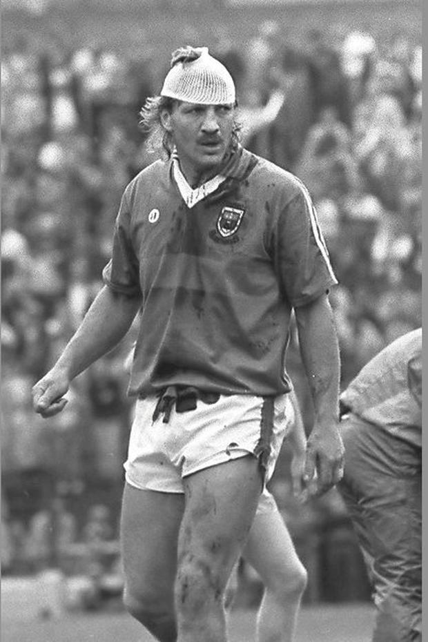 Willie Joe Padden with head bandage in the game against Tyrone in 1989