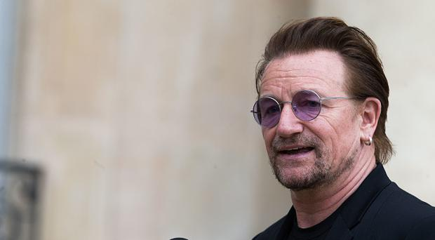 Bono, singer of U2 and cofounder of the NGO One, delivers a speech after his meeting with French President Emmanuel Macron (not pictured) during a press conference at the Elysee Palace on July 24, 2017 in Paris, France. (Photo by Nicolas Kovarik/IP3/Getty Images)
