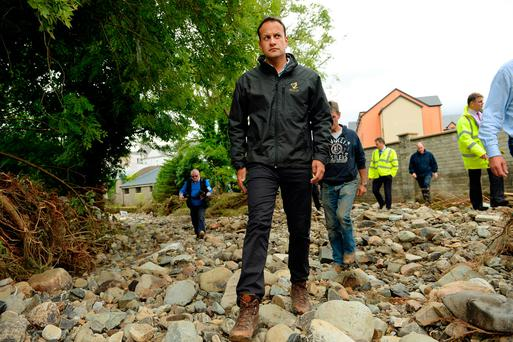 Taoiseach Leo Varadkar inspects the Glentogher River, which the floods caused to move from the site underneath him to several feet away. Carndonagh, Donegal. Picture: Caroline Quinn
