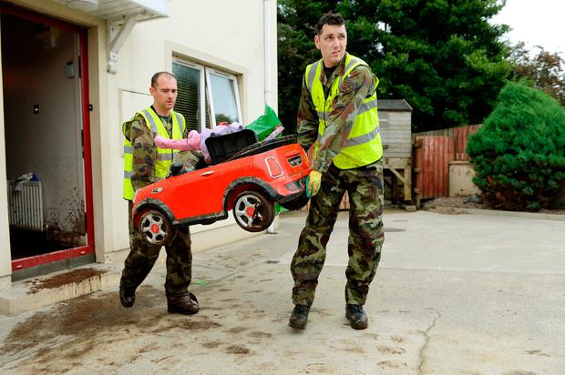 General view of Irish Defence Forces removing flood and sewage-damaged toy car from home in Pairc An Grianan estate, Burnfoot, Donegal. Picture: Caroline Quinn