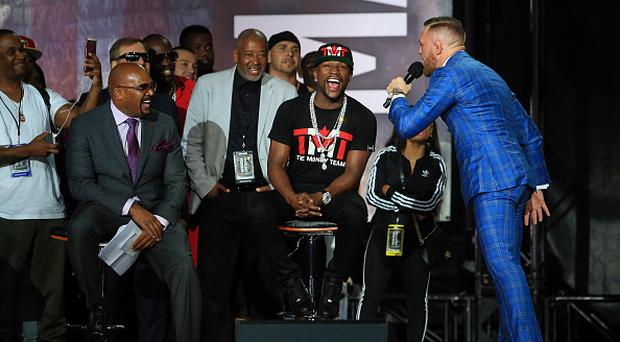Conor McGregor speaks to Floyd Mayweather Jr. during the Floyd Mayweather Jr. v Conor McGregor World Press Tour at Budweiser Stage on July 12, 2017 in Toronto, Canada. (Photo by Vaughn Ridley/Getty Images)