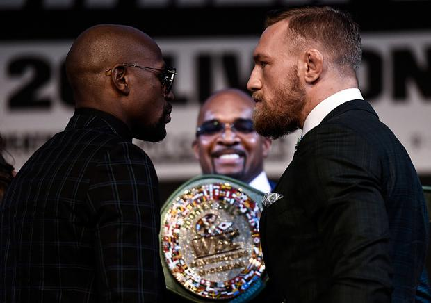 Boxer Floyd Mayweather Jr. and UFC lightweight champion Conor McGregor face off during a news conference at the KA Theatre at MGM Grand Hotel & Casino (Photo by Brandon Magnus/Zuffa LLC/Zuffa LLC via Getty Images)