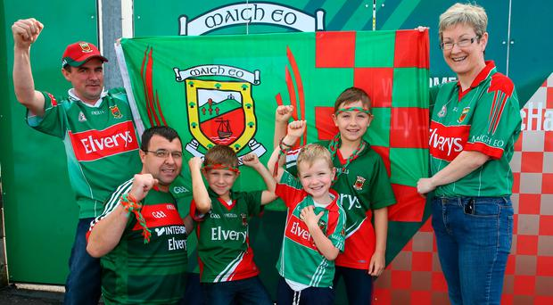 Mayo fans Declan, Frank, Andrea, Joseph, Sean and Ronan Quinn, from Castlebar, Co Mayo, ahead of today's All Ireland semi-final replay with Kerry. Photo: Michael Donnelly