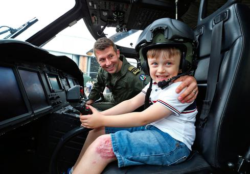 Gavin Chadwick (6), from Moneygall, who was accidentally run over by a ride-on lawn mower last May, with Capt. Alan Bray who transported him to hospital. Photo: Collins