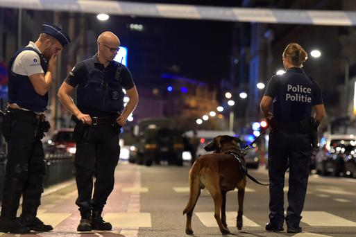 Policemen react on the scene after Belgian soldiers shot a man who attacked them with a knife, in Brussels, Belgium August 25, 2017. REUTERS/Eric Vidal