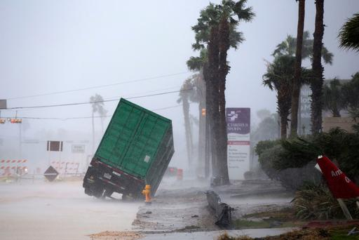 A power generator tips in in front of Texas' CHRISTUS (Courtney Sacco /Corpus Christi Caller-Times via AP)
