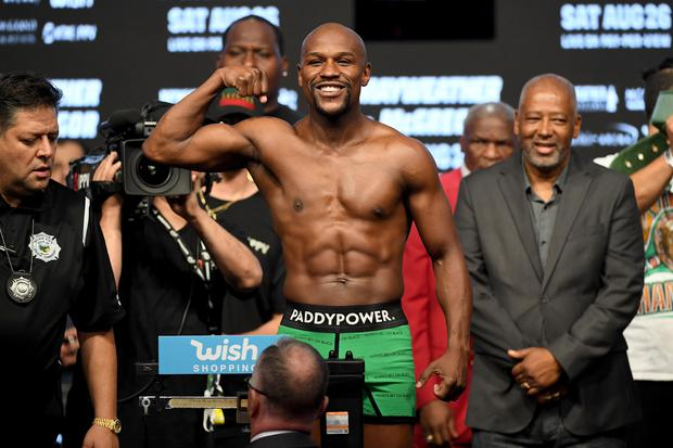 LAS VEGAS, NV - AUGUST 25: Boxer Floyd Mayweather Jr. poses on the scale during his official weigh-in at T-Mobile Arena (Photo by Ethan Miller/Getty Images)