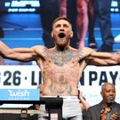 LAS VEGAS, NV - AUGUST 25: UFC lightweight champion Conor McGregor poses on the scale during his official weigh-in at T-Mobile Arena on August 25, 2017 in Las Vegas, Nevada. Mayweather will meet boxer Floyd Mayweather Jr. in a super welterweight boxing match at T-Mobile Arena on August 26. (Photo by Christian Petersen/Getty Images)