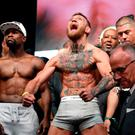 Floyd Mayweather and Conor McGregor of Ireland pose during their official weigh-in