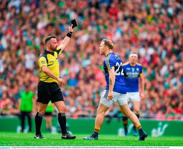 Darran O'Sullivan of Kerry remonstrates with referee David Gough as he is shown a black card