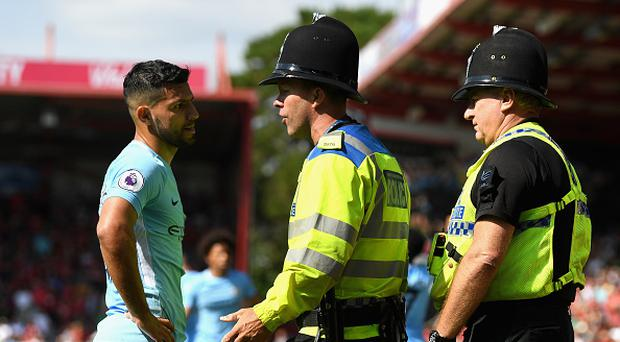 Sergio Aguero of Manchester City argues with a police man during the Premier League match between AFC Bournemouth and Manchester City at Vitality Stadium on August 26, 2017 in Bournemouth, England. (Photo by Mike Hewitt/Getty Images)