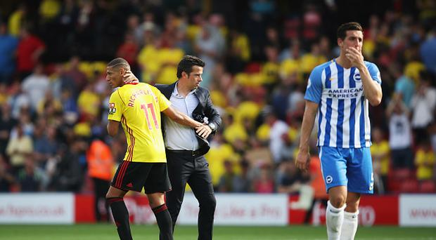 Richarlison de Andrade of Watford and Marco Silva, Manager of Watford embrace after the Premier League match between Watford and Brighton and Hove Albion at Vicarage Road on August 26, 2017 in Watford, England. (Photo by Julian Finney/Getty Images)