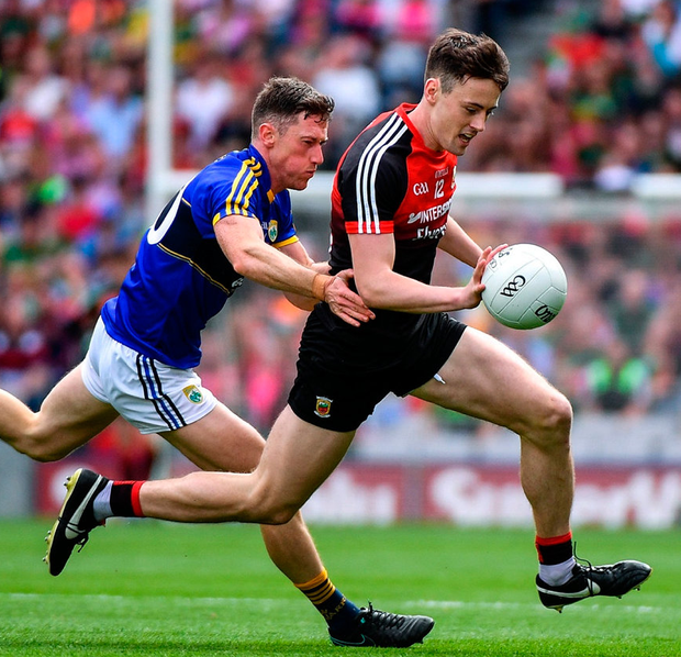 Mayo's Diarmuid O'Connor is challenged by Kerry's Jonathan Lyne during yesterday's All-Ireland semi-final replay Photo: Ramsey Cardy/Sportsfile