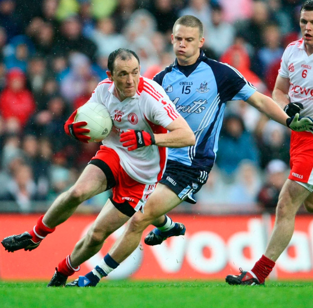 Tyrone's Brian Dooher, Tyrone, in action against Dublin's Tomas Quinnduring the All-Ireland Senior Championship Quarter-Final at Croke Park in August 2008. Photo: Oliver McVeigh/Sportsfile