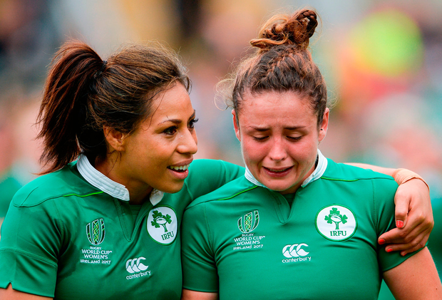 Ireland players Sene Naoupu and Larissa Muldoon show their disappointment after yesterday's defeat to Walesat Kingspan Stadium in Belfast Photo: Oliver McVeigh