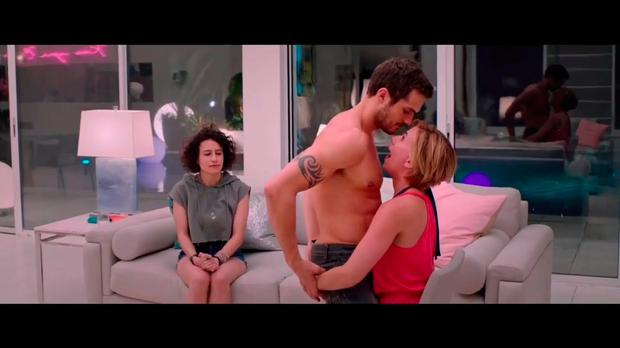 Ilana Glazer as Frankie watches bride-to-be Jess (Scarlett Johansson) get a lap dance that goes wrong in 'Rough Night'