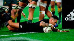 New Zealand's Aaron Smith scores a try during the second Bledisloe Cup match against Photo: MARTY MELVILLE / AFP / Getty Images
