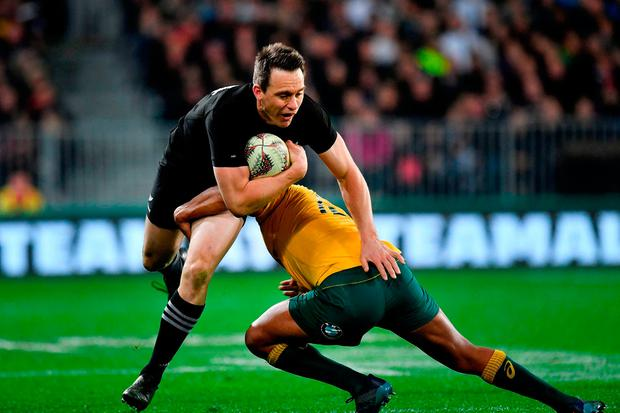New Zealand's Ben Smith (left) is tackled by Australia's Kurtley Beale Photo: Marty MELVILLE/AFP/Getty Images