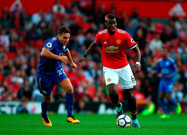 Manchester United's Paul Pogba (right) and Leicester City's Matty James battle for the ball Photo: Dave Thompson/PA Wire