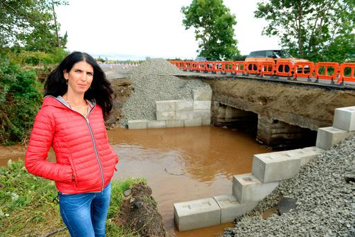 Kathy Donaghy pictured where the bridge along the Muff to Carndonagh road collapsed last Tuesday Photo: Caroline Quinn