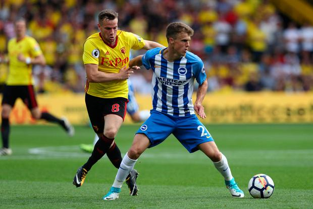 Watford's Tom Cleverley in action with Brighton's Solly March Photo: REUTERS/Eddie Keogh