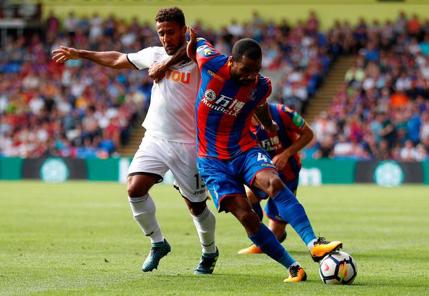 Crystal Palace's Jason Puncheon in action with Swansea City's Wayne Routledge Photo: REUTERS/Peter Nicholls