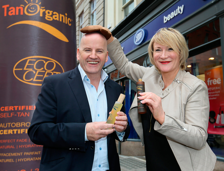 Sean Gallagher and Noelle O'Connor, of Tan Organic outside Boots on Grafton Street. Photo: Frank McGrath