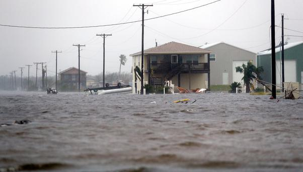 A home damaged by Hurricane Harvey remains surrounded by flood waters in Rockport, Texas Photo: AP Photo/Eric Gay