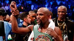 Boxing - Floyd Mayweather Jr. vs Conor McGregor - Las Vegas, USA - August 26, 2017 Floyd Mayweather Jr. celebrates with the belt after winning the fight REUTERS/Steve Marcus