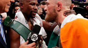 Floyd Mayweather embraces Conor McGregor