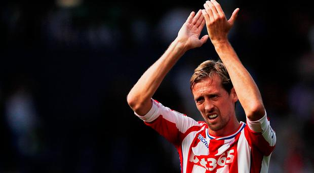 Stoke City's Peter Crouch applauds fans