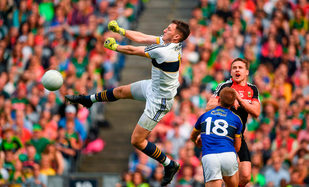 Kerry goalkeeper Brian Kelly punches the ball clear. Photo by Brendan Moran/Sportsfile