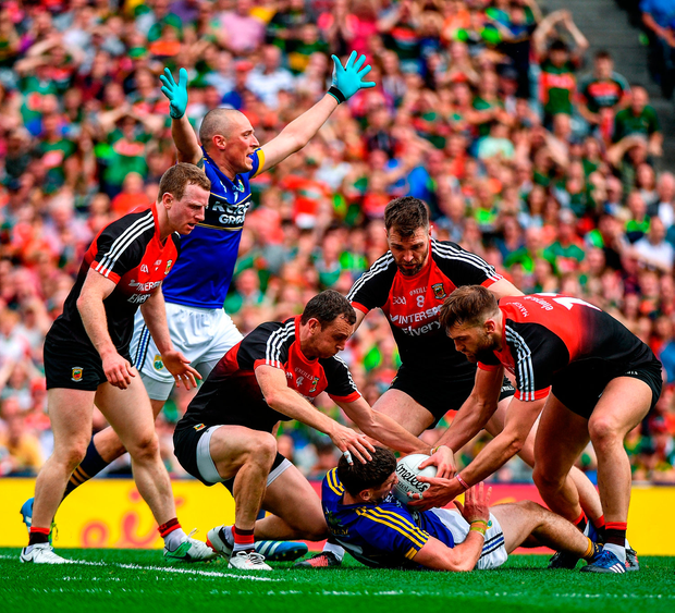 Paul Geaney of Kerry is tackled by Mayo players, from left, Colm Boyle, Keith Higgins, Séamus O'Shea and Aidan O'Shea. Photo by Ramsey Cardy/Sportsfile