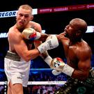 Floyd Mayweather catches Conor McGregor with a right hook during Saturday night's bout in Las Vegas. Photo by Christian Petersen/Getty Images
