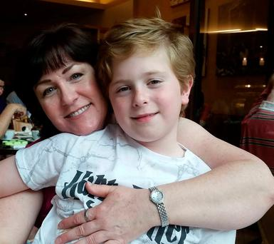 Declan McGinnis with his mother Tracy - the family is facing homelessness and the boys don't know yet where they'll be going to school this year