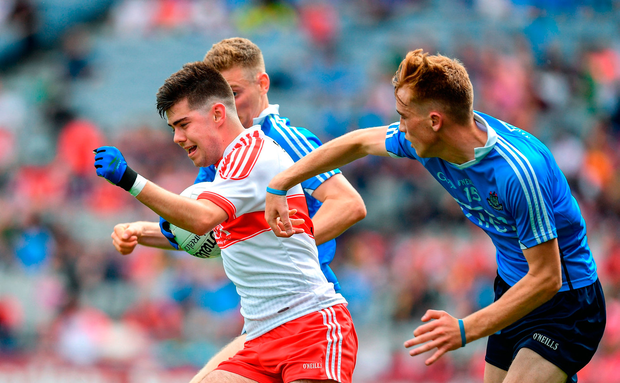 Simon McErlain of Derry in action against Daniel Brennan, left, and David Lace of Dublin. Photo by Ramsey Cardy/Sportsfile