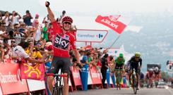 Chris Froome punches the air as he crosses the line to win the ninth stage of the Vuelta a Espana. Photo: Getty Images