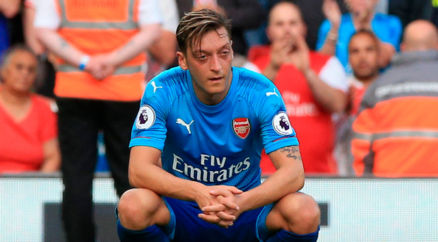 Arsenal's Mesut Ozil shows his dejection after the final whistle at Anfield. Photo: Peter Byrne/PA
