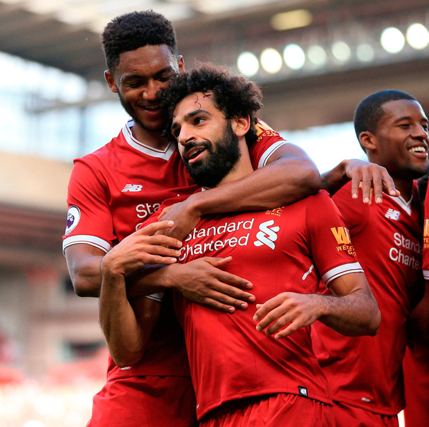 Liverpool's Mohamed Salah celebrates scoring his side's third goal of the game against Arsenal at Anfield. Photo: Peter Byrne/PA