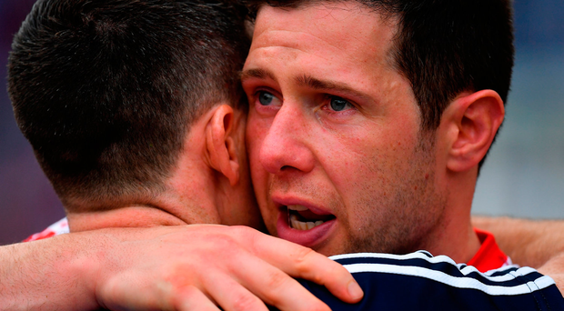 Sean Cavanagh embraces Dublin goalkeeper Stephen Cluxton at Croke Park yesterday. Photo by Brendan Moran/Sportsfile