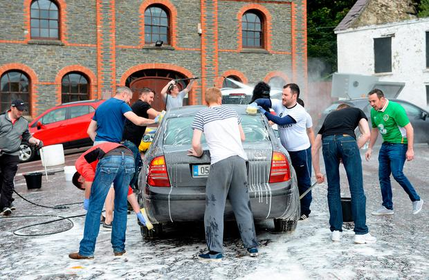 Local men in Clonmany, Donegal set up a Car Wash in aid of Flood Relief Fund. Clonmany, Co. Donegal. Picture: Caroline Quinn