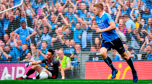 Dublin's Eoghan O'Gara wheels away after scoring his side's second goal with Tyrone goalkeeper Niall Morgan looking forlorn on the ground. Photo by Ramsey Cardy/Sportsfile