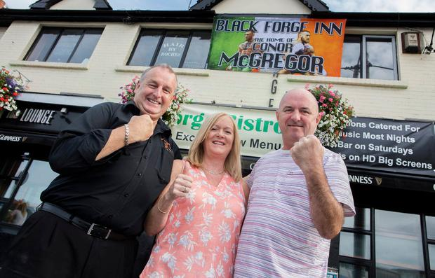 Liam Flynn, owner of the Black Forge Inn with Christine and Chris Keogh. Photo: Arthur Carron