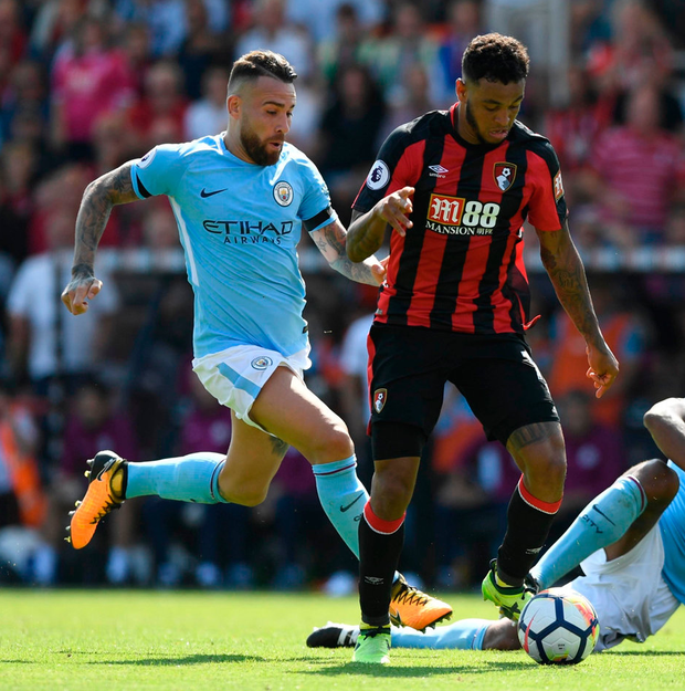 Bournemouth's Josh King in action against Manchester City's Vincent Kompany and Nicolas Otamendi. Photo: Tony O'Brien/Reuters