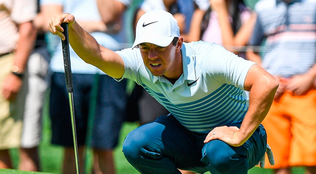 Rory Mcilroy lines up his putt during the third round of The Northern Trust golf tournament at Glen Oaks Club. Photo: Dennis Schneidler/USA Today Sports
