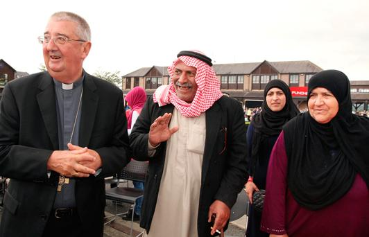Mahamid Aljali and his wife Hamadi and daughter Ola from Syria with Archbishop Diarmuid Martin of Dublin. Photos: John McElroy