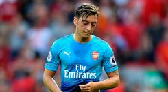 Mesut Ozil of Arsenal is dejected after the Premier League match between Liverpool and Arsenal at Anfield on August 27, 2017 in Liverpool, England. (Photo by Michael Regan/Getty Images)