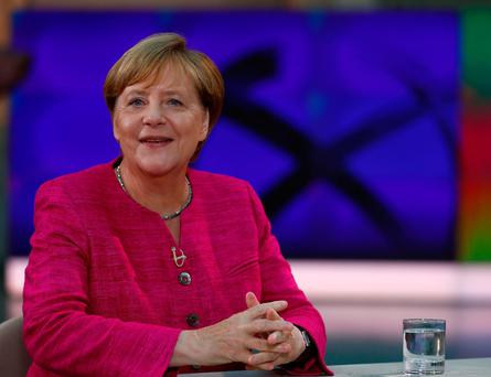 German Chancellor Angela Merkel arrives for a TV interview by ZDF public broadcaster in Berlin, Germany, August 27, 2017. REUTERS/Hannibal Hanschke
