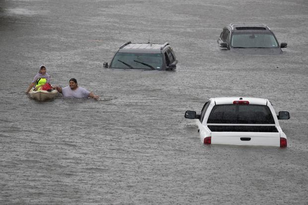 Jesus Rodriguez rescues Gloria Garcia after rain from Hurricane Harvey flooded Pearland, in the outskirts of Houston, Texas, U.S. August 27, 2017. REUTERS/Adrees Latif