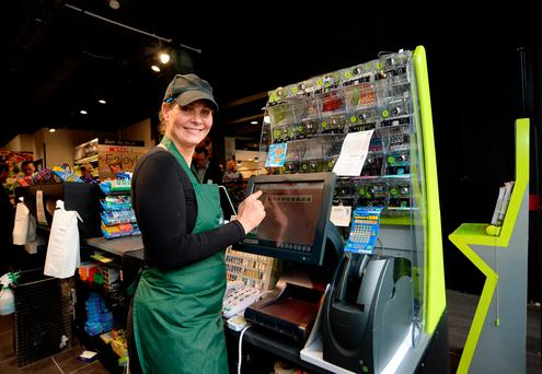 Shop manager Ulrika Campbel at the Lotto machine which printed the winning Lotto ticket for Saturday night's jackpot Picture: Caroline Quinn